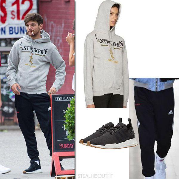 Louis Tomlinson in grey hoodie and black track pants