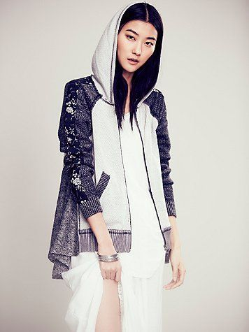 Textured Piece Zip Up Hoodie | This zip up hoodie is a mix of different patterns and textures.  Hem is longer on the sides.  Front pockets.