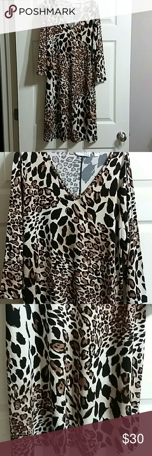 Shift dress Leopard print shift dress 3/4 sleeves. Very cute, light weight shift dress. Bundle with sandals for discount on both. Shoes $30 Dresses Mini