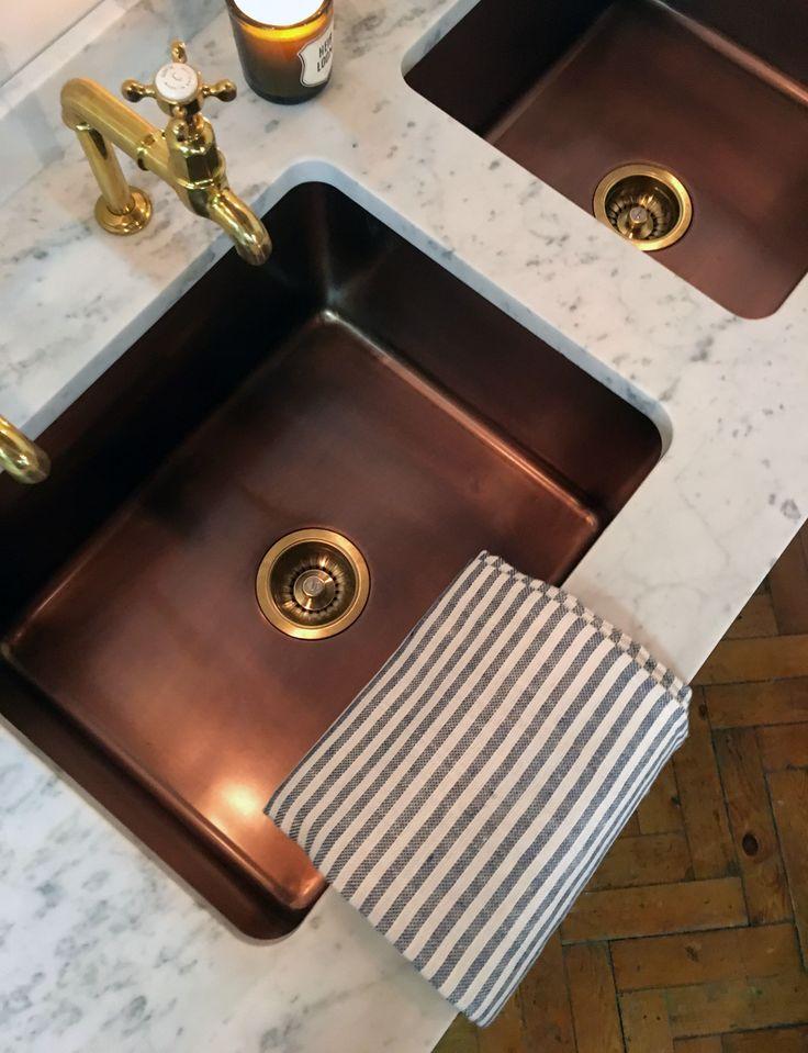 beautiful copper sinks in deVOL's Clerkenwell Design Week display