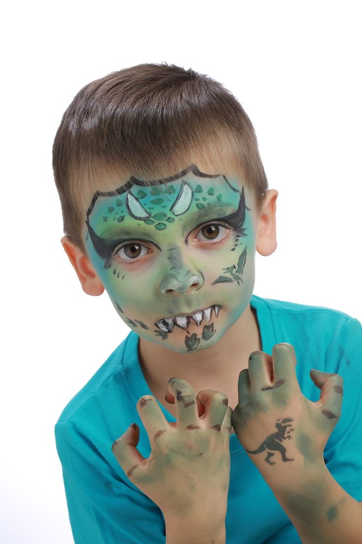 """Pour réaliser ce maquillage """"Dinosaure"""", il vous faudra : Matériel : - Pinceau fin - Pinceau moyen - Éponge - Galets de maquillage à l'eau sans paraben GRIM'TOUT: Vert Anis, Vert Pré, Bleu Lagon, Noir, Blanc"""