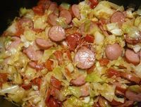 Cabbage Sausage Skillet With A Twist - I make cabbage and sausage often! It's a cheap, nutritious and filling dinner that also just happens to be super yummy. But this is my first time making it with this twist. A must try recipe!