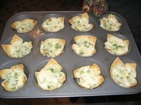 Baked Crab Rangoon    Ingredients: •1 (6 ounce) can crabmeat, drained, flaked (may substitute for artificial crab meat)   •4 ounces cream cheese   •1/4 cup green onion   •1/4 cup mayonnaise   •12 wonton wrappers   •paprika (optional)  Directions:   1.  PREHEAT oven to 350°F.