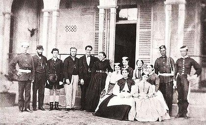 Governor Blackall's servants; (L-R) orderly/guard, gardener, coachman, butler, footman, housekeeper, kitchen and housemaids, orderlies/guards. The butler is supposed to haunt the house today. Photo: National Library of Australia