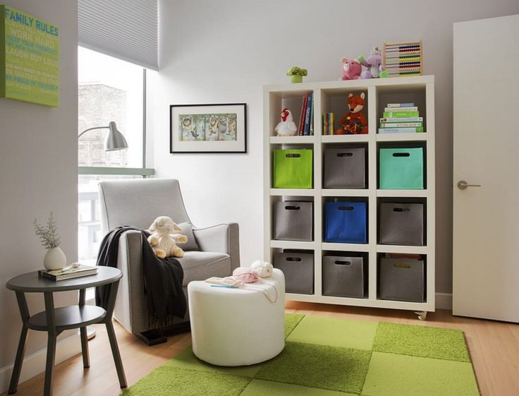 Baby Nursery White Leather Sofa With Square White Wooden Bookcase Also Round Black Stained Wood Table And Monochromatic Flor Rug Besides  Makes Comfortable Nursery with Flor Rug