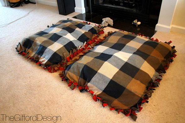 Dog bed DIY  Hit up the fabric store (pick a size) two equal squares, cut up sides and tie them. After three sides are cut and tied stuff it with what ever you desire then finish the final side.