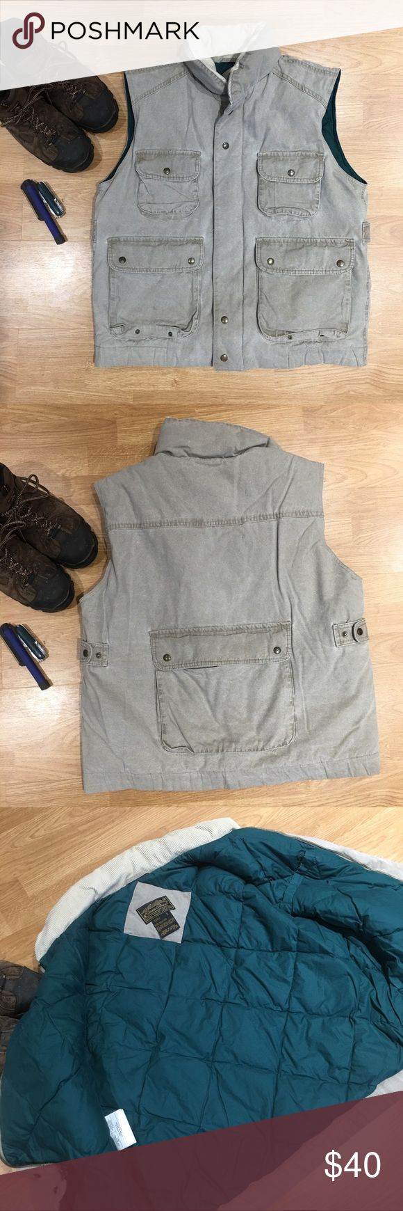 Eddie Bauer Atlas Traveler Hiking/Utility Vest Hiking/Utility goose down vest with 5 pockets including one on the back. Also has one inside chest Velcro pocket. Men's size large. In great condition! Has one tiny spot on the front pocket that you can see in the first pic. Eddie Bauer Jackets & Coats