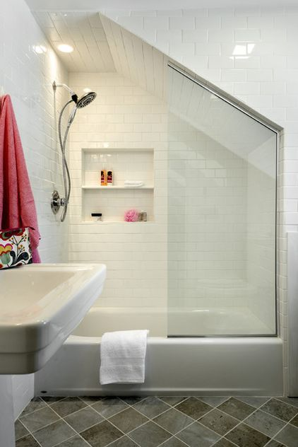Shower screens utilize tricky spaces. A bath can be slotted rather neatly into an unused alcove or nook in a converted attic, but to cope with the sloping ceilings your best bet is to opt for a custom shower screen (lots of companies now offer them), which can accommodate tricky recesses and angles as well as nonstandard heights. Traditional Bathroom by Crisp Architects