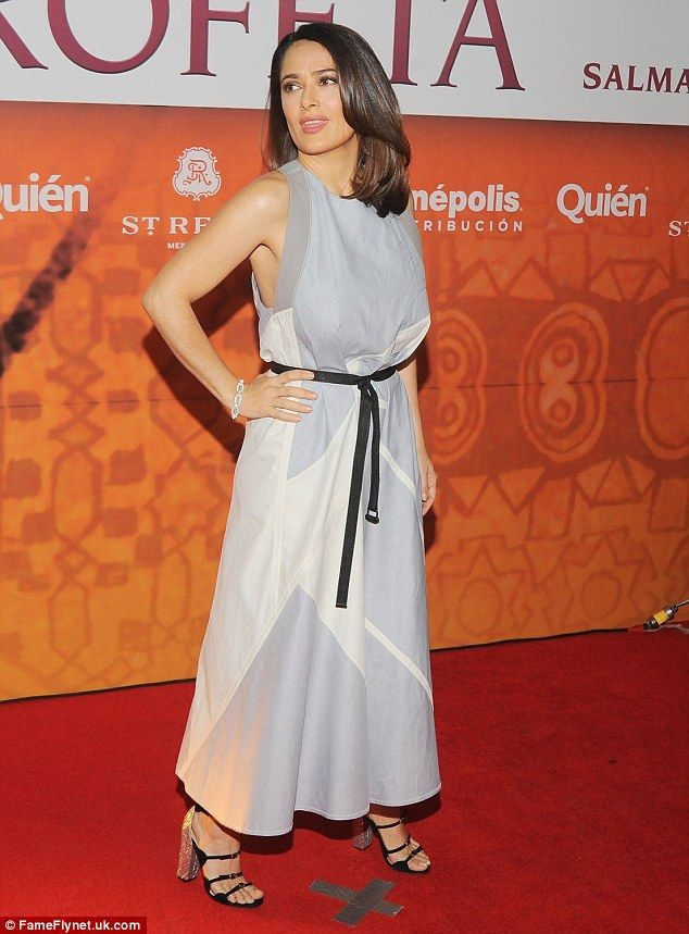 Strike a pose: The petite actress gave herself height with chunky heels that featured five...