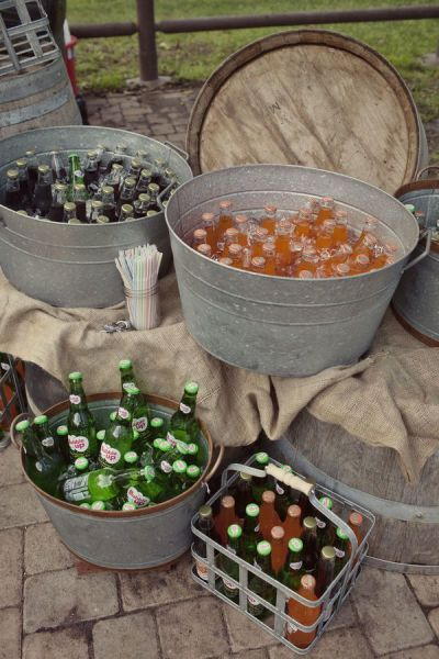 galvanized tubs for drinks -   (via Style Me Pretty) did this for a 20's theme party with little bottles of wiskey.