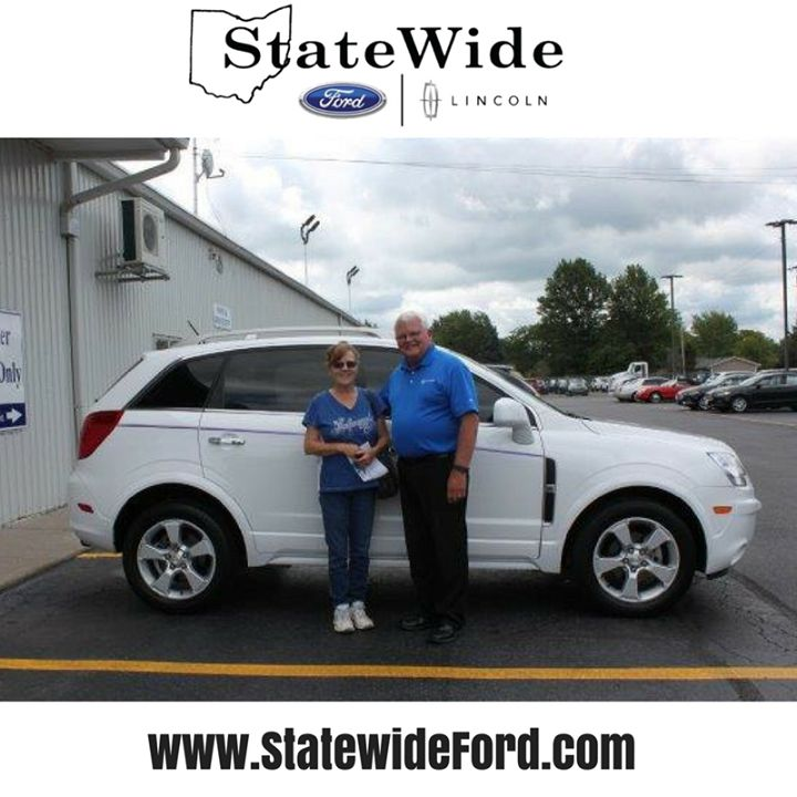 Sandra Williamson taking delivery of her new Chevy Captiva Sport from Randy Custer. Thank you for your business!