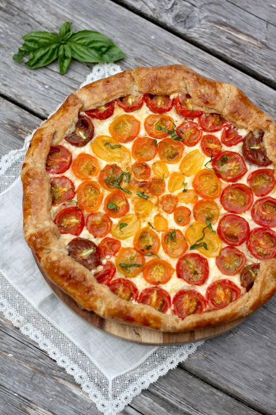Cherry Tomato Galette is a savory pie that looks like a reverse pizza with the tomatoes on top of the cheese in a flaky tart crust.