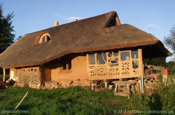 Roundwood framed building using straw bale and cobwood walls