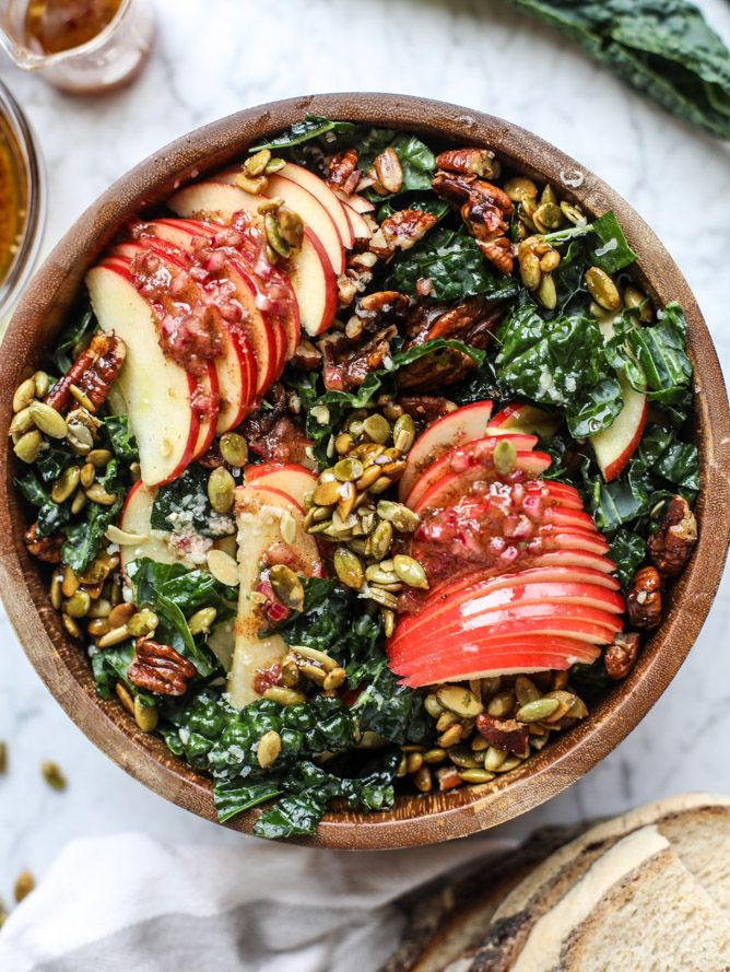 The best fall kale salad made with honeycrisp apples, tuscan shredded kale, smoky pepita clusters and sweet and spicy pecans!