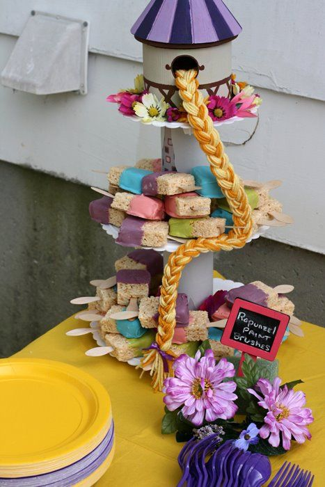 Stand with cake plates and Pringles tubes with bird house on top!