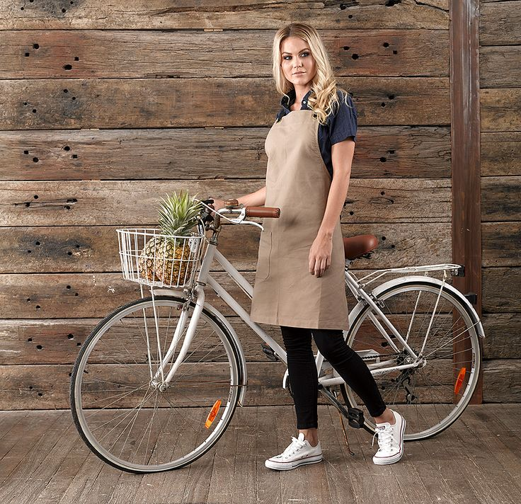 Hospitality uniform featuring tan apron and denim shirt. Perfect for the casual kitchen