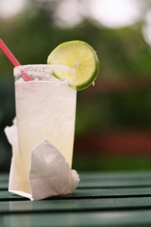 Low-cal margarita: tequila, lime juice, and a tiny bit of agave syrup or Cointreau -- skip premade mixes.