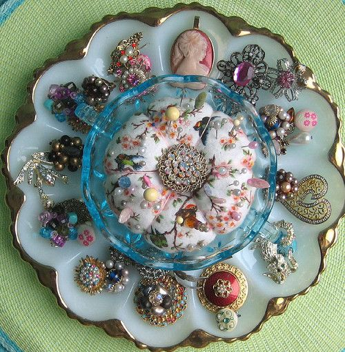 What a cool way to display your vintage jewelry -- the bottom is a 60s era egg serving dish in milk glass, not hard to find and should be cheap