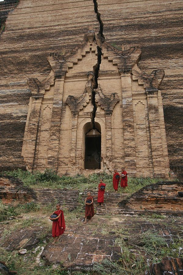 Young Buddhist monks near a ruined temple in Myanmar...There's a crack, a crack in everything, that's how the light gets in.