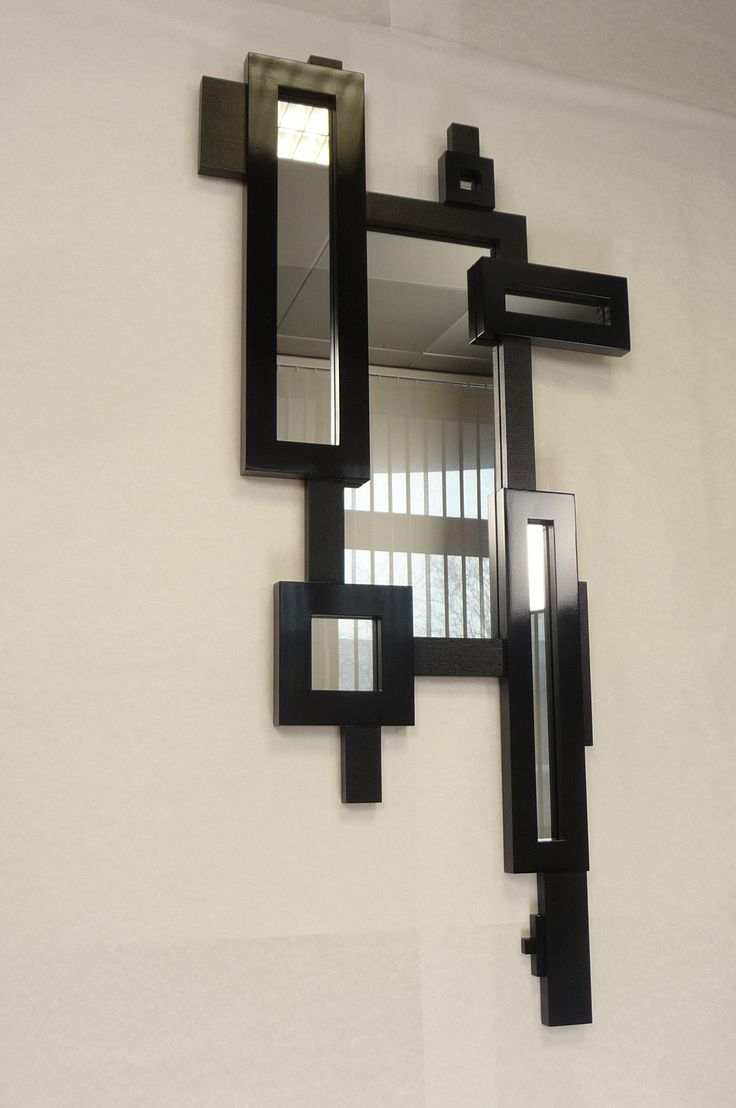 Each box holds a mirror - each mirror a frame, each frame jet black glossy & smooth... The additional link frames and details  are all matt black and textured..!