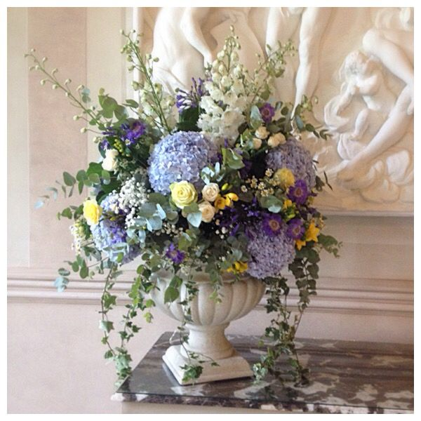 Blue White And Yellow Pedestal Arrangement Of Delphiniums