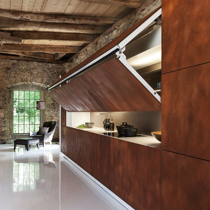 Cute warendorf germany kitchen remodelista The Hidden Kitchen by German pany Warendorf has an electronic panel that lifts at the push of a button