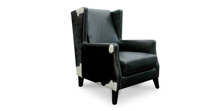 The Essex Lounge Chair from Hunter Furniture.  Beautiful design combines premium cow hide & black leather to create this impressive chair. #furniturehunters
