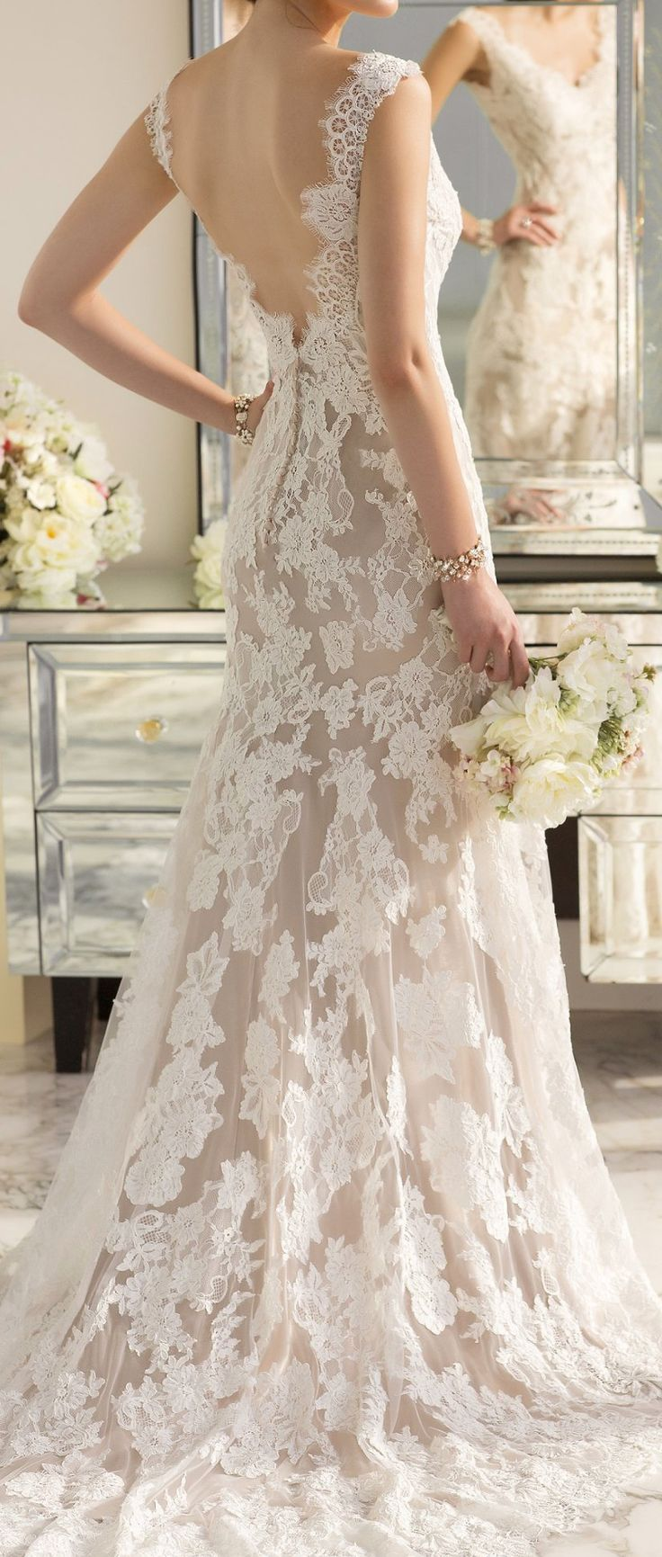 Beautiful lace with an almost dual-tone to really make it pop. Not sure if I'd want lace ALL over, but it's a beautiful statement  pronoviasweddingdress.com