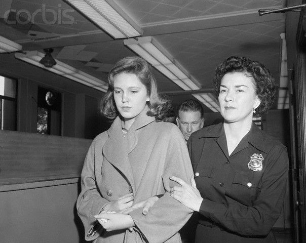 Beverly Hills, California: Cheryl Crane (left), daughter of Steve Crane and actress Lana Turner, is escorted from the jail here to juvenile hall in Los Angeles by policewoman Margaret Weissberg, April 5th. Cheryl says she knifed Johnny Stompanato, Miss Turner's gangland boyfriend, to death when he threatened to disfigure the actress. (April 5, 1958)