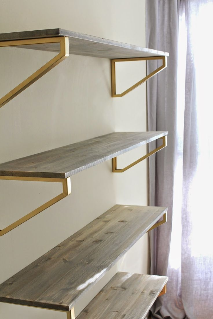 Cup Half Full: Rustic Wood Shelf DIY [using Ikea EKBY LERBERG brackets painted gold, and gray stained shelves]