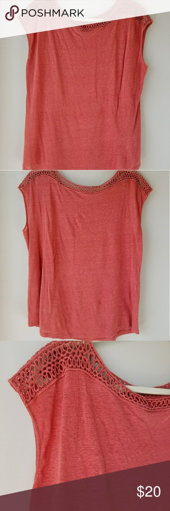 """Coral top with crochet detail This 100% linen top from Loft is very flowy with a unique, subtle crochet detail on the neckline and shoulders.  The shirt does not wrinkle like a typical linen top, however it does have a linen texture up close that looks somewhat like very light pilling.  I have taken a fabric shaver to the top, to make sure it's not pilled. The color is a muted coral/salmon color, not as vibrant as the photos. VGUC, no pulls or stains. Smoke free/pet free. 22"""" chest, 27""""…"""