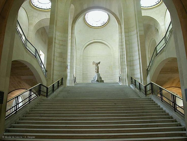 The staircase of the Winged Victory of Samothrace and the Arago medallion in The Louvre