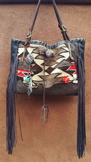 All of my bags are made by hand and each is one-of-a-kind, incorporating a combination of retired vintage Navajo blankets / rugs, vintage or gently-used horse tack, and deer, elk or cowhide leathers. I embellish the bags with vintage trade beads, turquoise, coral, nickel silver/German silver Concho buttons, nickel silver spots/studs, and deer antler tips. Pillow ticking or unbleached muslin is used for the linings, and all the fringe is hand-cut. Ooo So Santa Fe