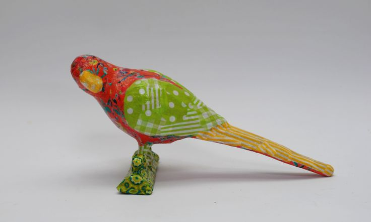 This cheerful parrot will be happy perched anywhere you choose!