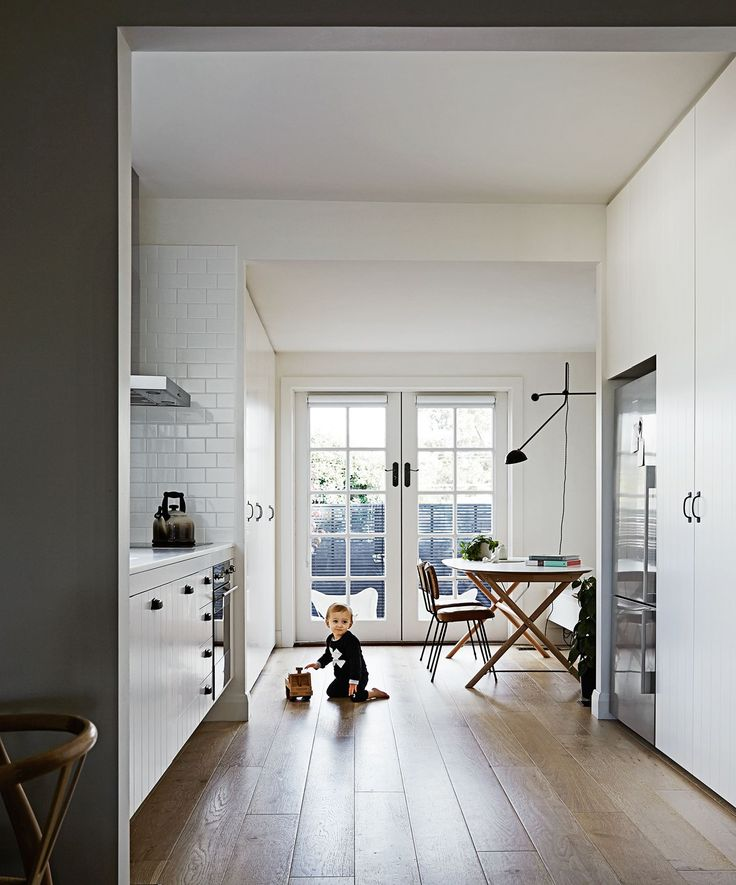 """""""I love my kitchen!"""" Rhiannon says. """"While it's petite in size, its layout is super-functional."""" Clutter is housed by floor-to-ceiling joinery by [Avram Construction](http://www.avramconstruction.com.au/ target=""""_blank"""")."""