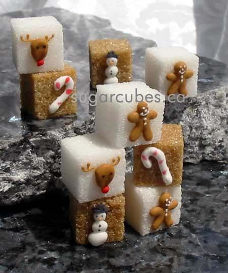 Old fashioned Christmas sugar cubes.  Gingerbread man, Rudolf, candy cane and a snowman...table cuteness in a box!