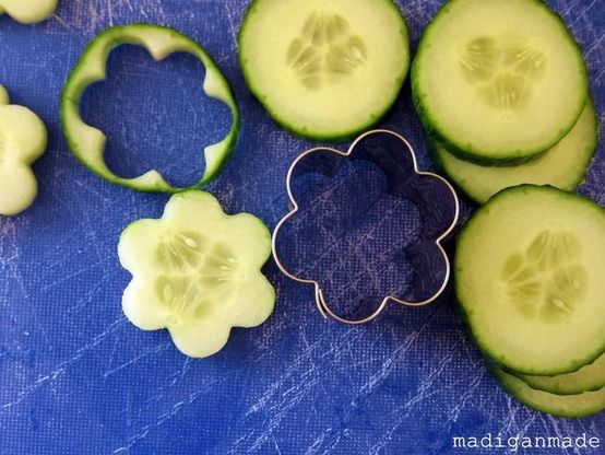 Use a cookie cutter to make cucumber flowers. And then you don't have to peel them. Cute idea to put in drinking water or tea sandwiches!