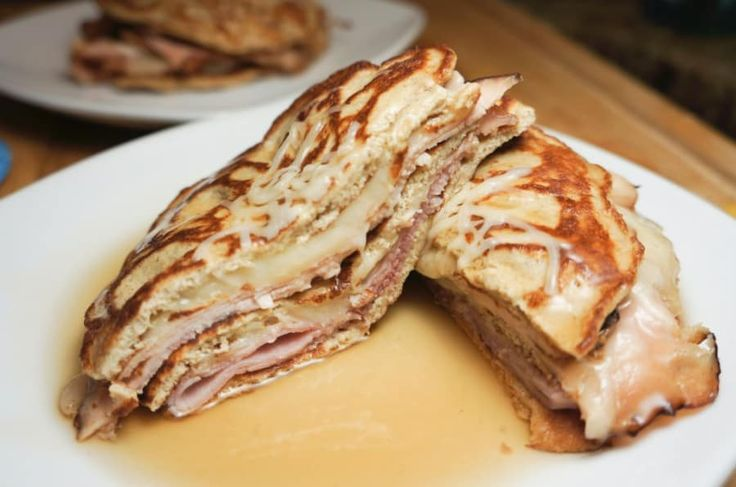 This monte cristo compiles rosemary ham, maple-cured turkey and swiss cheese, layered between four light cream cheese ketogenic pancakes with sugar-free maple syrup for dipping.Recipe here.