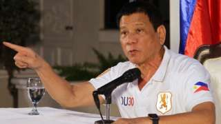 Image copyright                  EPA Image caption                                      Mr Duterte became mayor of Davao in 1988                                Philippine President Rodrigo Duterte allegedly once shot dead a justice department agent with an Uzi submachine gun while serving as mayor of Davao.  The allegation was made by Edgar Matobato, a self-confessed former death squad member, before a Senate inquiry on extra-judicial killing