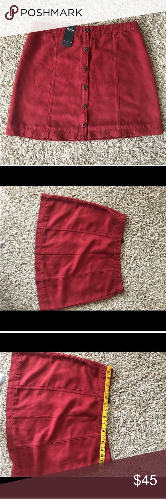 NWT Hollister Skirt Red Button of the front NWT Hollister Skirt. Size 9. Soft suede type feel material. Reddish burgundy color. Buttons down the front. In new condition. Comes from smoke free and clean home. Remember to bundle when you save. Thanks Hollister Skirts Mini