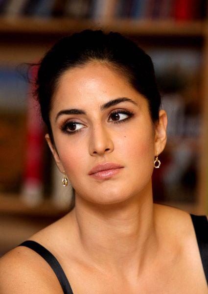 "Indian Bollywood actress Katrina Kaif unveils the book of producer-director Prakash Jha's film ""Raajneeti"" in Mumbai on March 29, 2012."