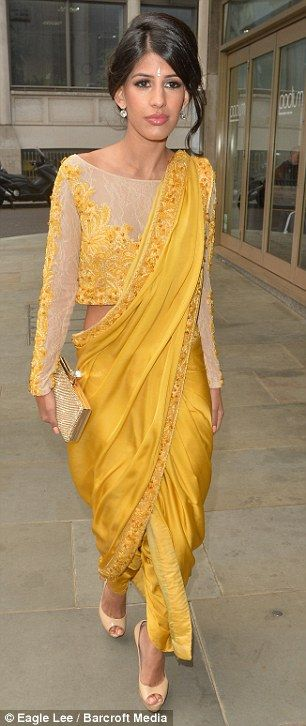 What a beauty: Jasmin paired her sari with a pair of her favourite towering platform heels and a sparkly clutch