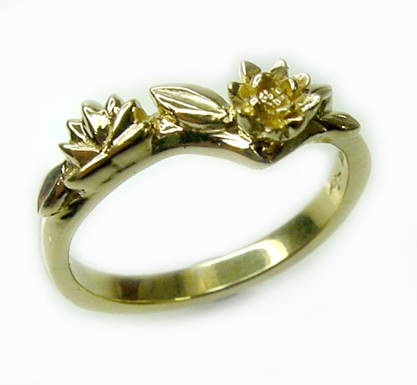 Chibnalls custom made 18ct gold wedding ring Lilly motif.