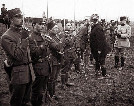 Gen Joffre presents awards to French officers fighting at Verdun, March 1916. Several of them wear the fez of colonial troops