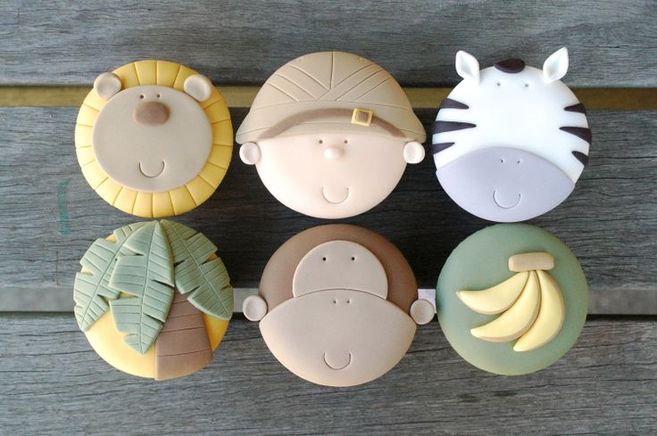 I found these safari fondant tutorial for cupcakes at etsy...Jungle Safari 6 Cupcake Tutorial Set. $18.95, via Etsy.