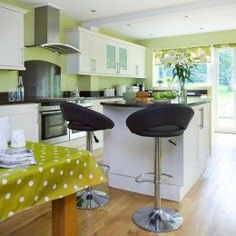 Lime green kitchen with white cabinetry