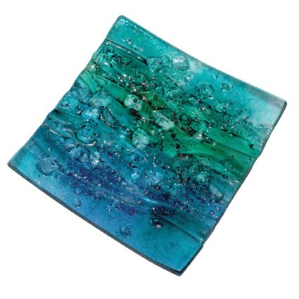 Stunning piece of handmade, fused glass art in the form of a striking dish. The design here is called Seascape and is a textured and bubbles piece of aqua blue and green glass. It is textured with fused glass pebbles so you can feel the 'water bubbles' on the design. A stunning piece to attract attention on your table! Approximately 30x30cm. As these are handmade, no two will be identical.