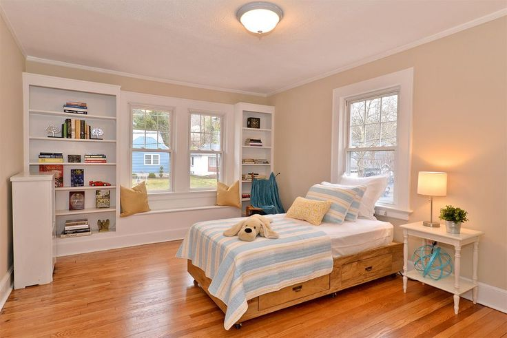 Contemporary Kids Bedroom with Wedgewood End Table, Crown molding, Northledge Flush Mount, Built-in bookshelf, Window seat