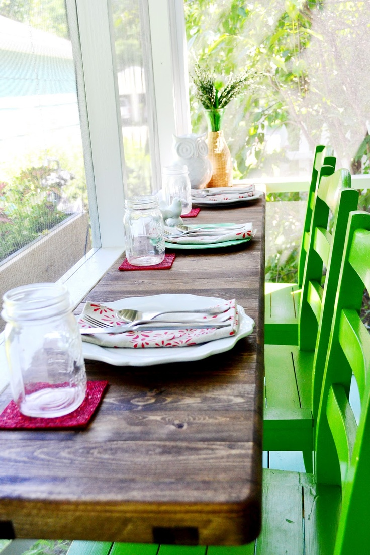 screen porch - love everything! Use of small space on a screened porch for additional dining space (or a buffet!), distressed mini-table, older chairs in vivid color, mason jar glasses, etc etc