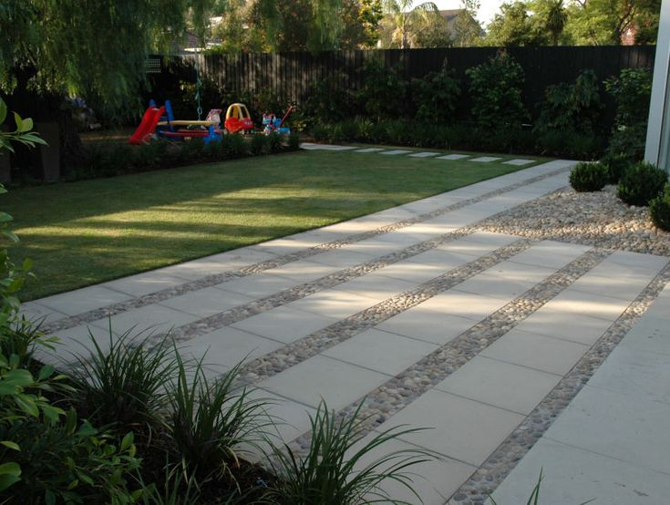 Eco Outdoor Eggshell pebbles laid in situ using mortar between concrete pavers